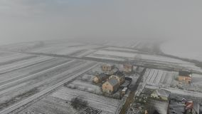 Winter came. Aerial view of rural area, village. Fly forward technique, 4k stock footage