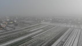Winter came. Aerial view of rural area, village. Fly forward technique, 4k stock video