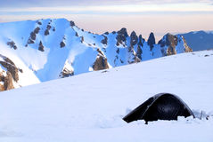 Winter camping. High altitude winter camping in Romania Royalty Free Stock Images
