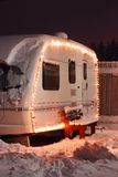 Winter camping holiday. Decorated garland. white Caravan Stock Photography