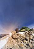 Winter camping in the mountains with a backpack and tent. Camping on the top of the mountain in winter Royalty Free Stock Photography
