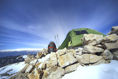 Winter camping in the mountains with a backpack and tent. Camping on the top of the mountain in winter Stock Photos