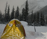 Winter Camping Tent. Photo of an all season tent during deep of winter in the mountains Royalty Free Stock Photography
