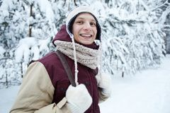 Winter Camping. Waist up portrait of active young man smiling at camera while enjoying hike in beautiful winter forest, copy space stock images