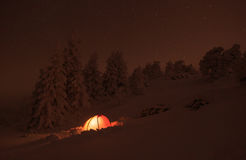 Winter campsite. Red tent in the snow of the Vercors mountains in France royalty free stock images