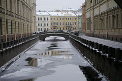 Winter Canal and the 2nd Winter Bridge in Saint-Petersburg Royalty Free Stock Photography