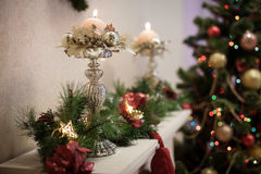 Winter candle holders with candles at the Christmas tree background Royalty Free Stock Image