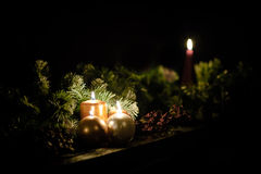 Winter candles on a bench with seasonal garlands Royalty Free Stock Images