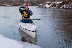 Winter canoe - break for hot tea Royalty Free Stock Image