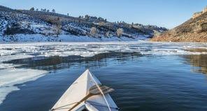 Winter canoe paddling Stock Photo