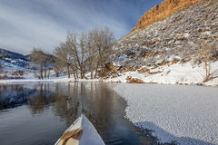 Winter canoe paddling in Colorado Royalty Free Stock Image