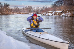 Winter canoe paddling in COlorado royalty free stock images