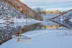 Winter canoe paddling Royalty Free Stock Photo