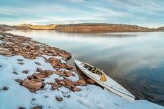 Winter canoe paddling Stock Photos