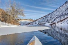 Winter canoe paddling Royalty Free Stock Photos