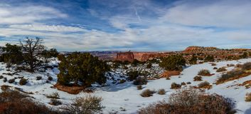 Winter canyon in Arizona. With snow and trees on the foreground under beautiful clouds Stock Photo