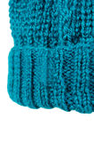 Winter cap portion. Winter soft warm blue knitted hat with braids patterns handmade isolated Stock Image