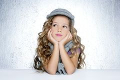 Winter cap wool scarf little fashion girl portrait royalty free stock images