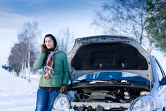 Winter car breakdown - woman call for help. Road assistance Royalty Free Stock Images