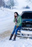 Winter car breakdown - woman call for help royalty free stock photo