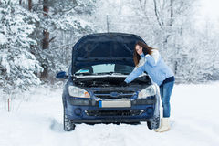 Winter car breakdown - woman call for help. Royalty Free Stock Images