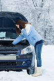Winter car breakdown - woman call for help. Royalty Free Stock Photos