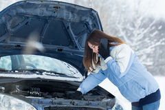 Winter car breakdown - woman call for help. Stock Photo
