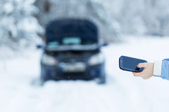 Winter car breakdown - woman call for help. Winter car breakdown - woman try to repair motor Royalty Free Stock Photo