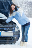 Winter car breakdown - woman call for help. Stock Photography