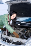 Winter car breakdown - woman repair motor Royalty Free Stock Image