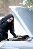 Winter car breakdown - young beautiful woman call for help, road Stock Images