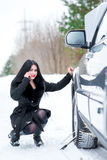 Winter car breakdown - young beautiful woman call for help, road Royalty Free Stock Photos