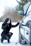 Winter car breakdown - young beautiful woman call for help, road Royalty Free Stock Image
