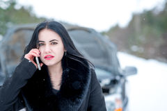 Winter car breakdown - young beautiful woman call for help, road Stock Image