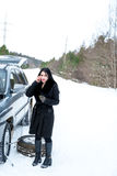 Winter car breakdown - young beautiful woman call for help, road Stock Photo