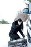 Winter car breakdown - young beautiful woman call for help, road Royalty Free Stock Images