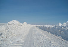Winter car drive. Winter snow track for cars Stock Images