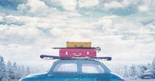 Winter car with luggage on the roof ready for summer vacation royalty free stock photography