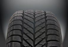Winter car tire. Brand new modern winter car tire Stock Images