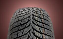 Winter car tire. Brand new modern winter car tire Royalty Free Stock Image