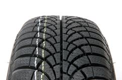 Winter car tire. Fragment A brand new modern winter car tire Royalty Free Stock Photo