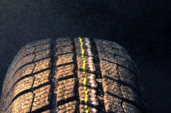 Winter car tire in rain Stock Images