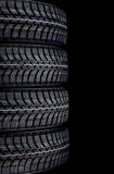 Winter car tires isolated on black Stock Images