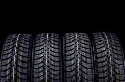 Winter car tires isolated on black background Royalty Free Stock Photos
