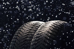 Winter Car tires with snow on black Royalty Free Stock Images