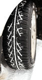 Winter car tyre in the snow Royalty Free Stock Images