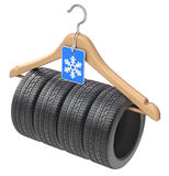Winter car tyre on wooden hanger Stock Photo