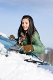 Winter car - woman remove snow from windshield Stock Image