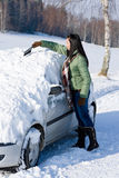 Winter car - woman remove snow from windshield Stock Photography
