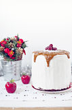 Winter caramel cake. White winter cake with caramel drizzle and winter festive decorations Royalty Free Stock Photos